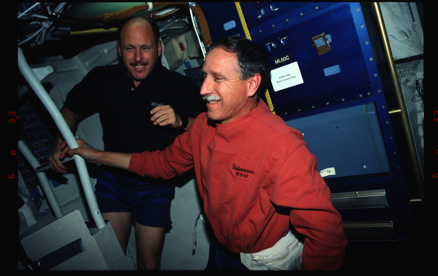STS061-02-034 - STS-061 - Various views of the STS-61 crew on the Endeavour's middeck