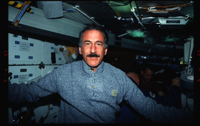 STS061-02-035 - STS-061 - Various views of the STS-61 crew on the Endeavour's middeck