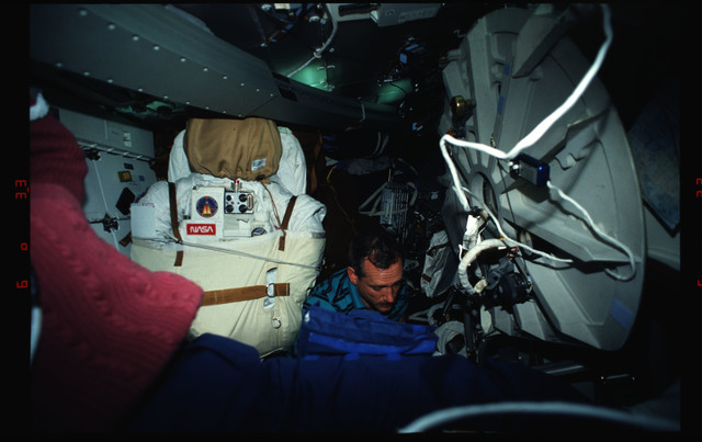 STS061-03-014 - STS-061 - Various views of the STS-61 crew on the middeck with EVA equipment