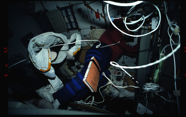 STS061-03-015 - STS-061 - Various views of the STS-61 crew on the middeck with EVA equipment