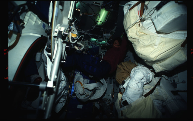 STS061-03-016 - STS-061 - Various views of the STS-61 crew on the middeck with EVA equipment