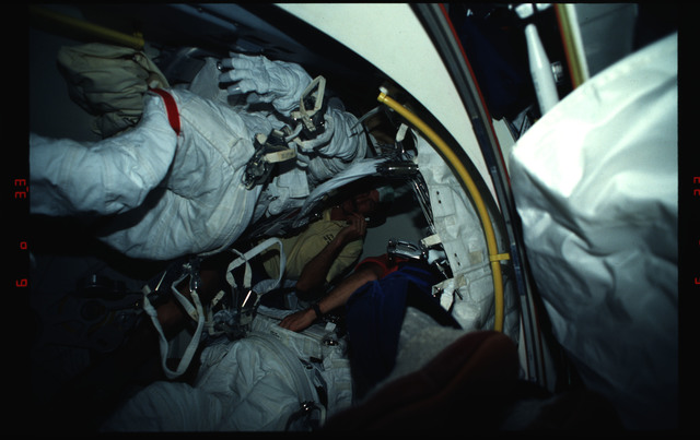 STS061-03-017 - STS-061 - Various views of the STS-61 crew on the middeck with EVA equipment