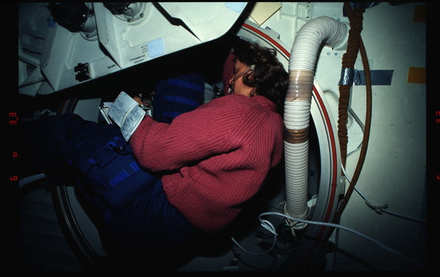 STS061-03-020 - STS-061 - Various views of the STS-61 crew on the middeck with EVA equipment