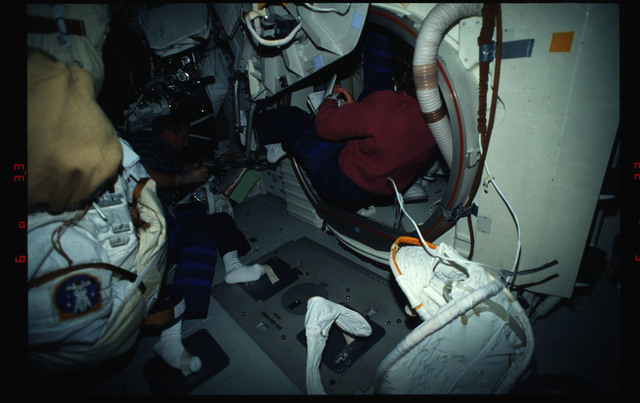 STS061-03-022 - STS-061 - Various views of the STS-61 crew on the middeck with EVA equipment