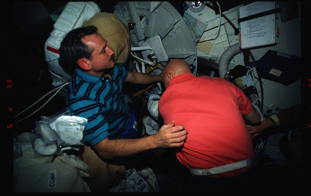 STS061-03-023 - STS-061 - Various views of the STS-61 crew on the middeck with EVA equipment
