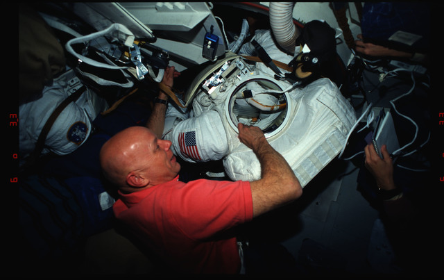 STS061-03-024 - STS-061 - Various views of the STS-61 crew on the middeck with EVA equipment