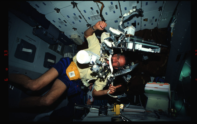 STS061-03-026 - STS-061 - Various views of the STS-61 crew on the middeck with EVA equipment
