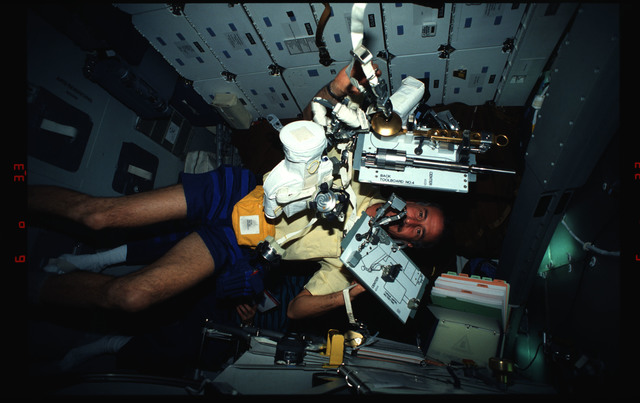 STS061-03-027 - STS-061 - Various views of the STS-61 crew on the middeck with EVA equipment