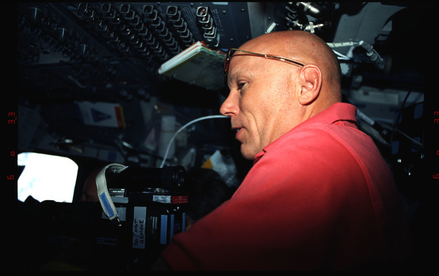 STS061-04-010 - STS-061 - Various views of the STS-61 crew on the flight deck during HST capture