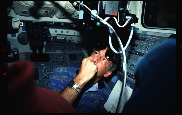 STS061-04-012 - STS-061 - Various views of the STS-61 crew on the flight deck during HST capture