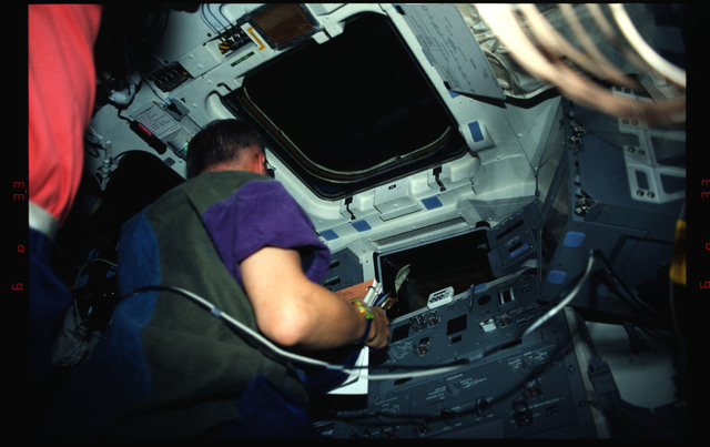 STS061-04-019 - STS-061 - Various views of the STS-61 crew on the flight deck during HST capture