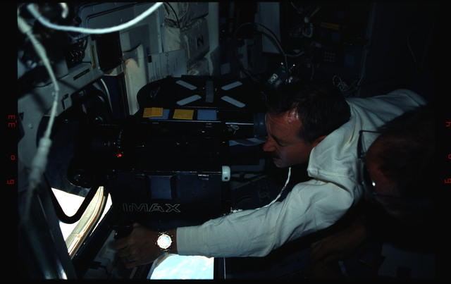 STS061-04-020 - STS-061 - Various views of the STS-61 crew on the flight deck during HST capture