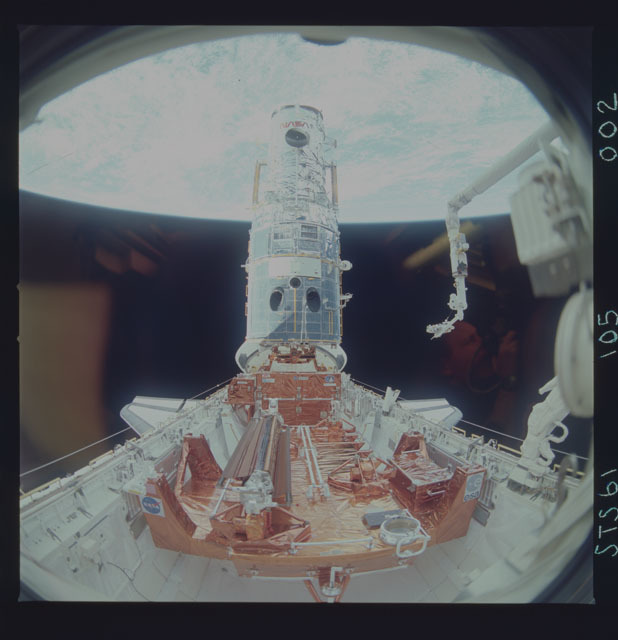 STS061-105-002 - STS-061 - Various views of the third of five EVA's performed to repair HST