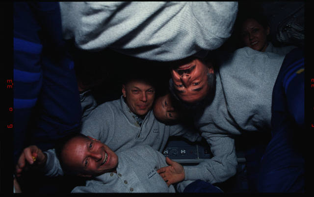 STS061-11-022 - STS-061 - Various views of the STS-61 crew on the middeck