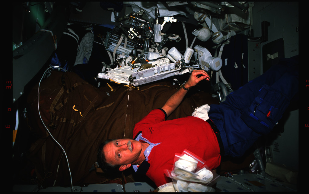 STS061-16-013 - STS-061 - Various views of the STS-61 crew on the middeck with tools