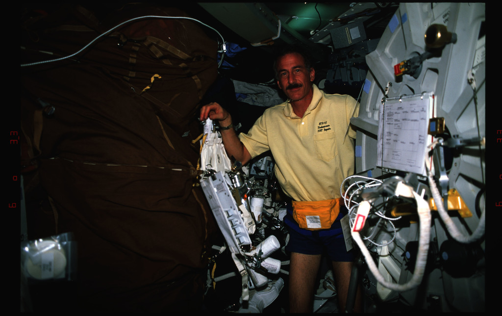STS061-16-014 - STS-061 - Various views of the STS-61 crew on the middeck with tools