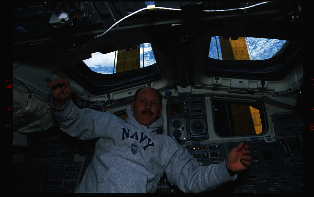 STS061-22-028 - STS-061 - Various views of the STS-61 crew on the Endeavour's aft flight deck