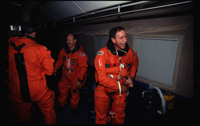 STS061-29-023 - STS-061 - Post landing views of STS-61 crew with KSC personnel and families