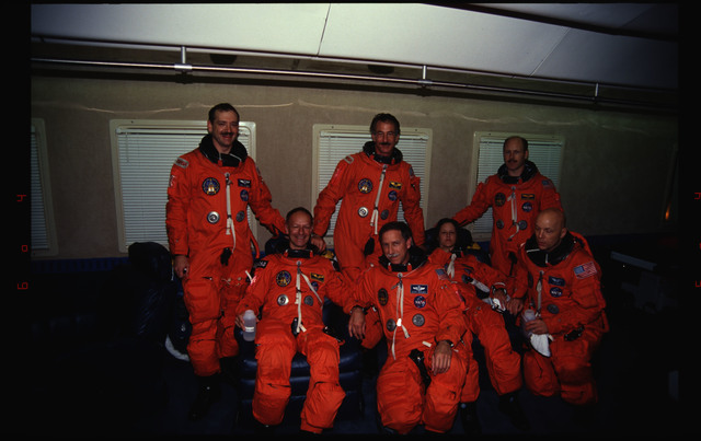 STS061-29-025 - STS-061 - Post landing views of STS-61 crew with KSC personnel and families
