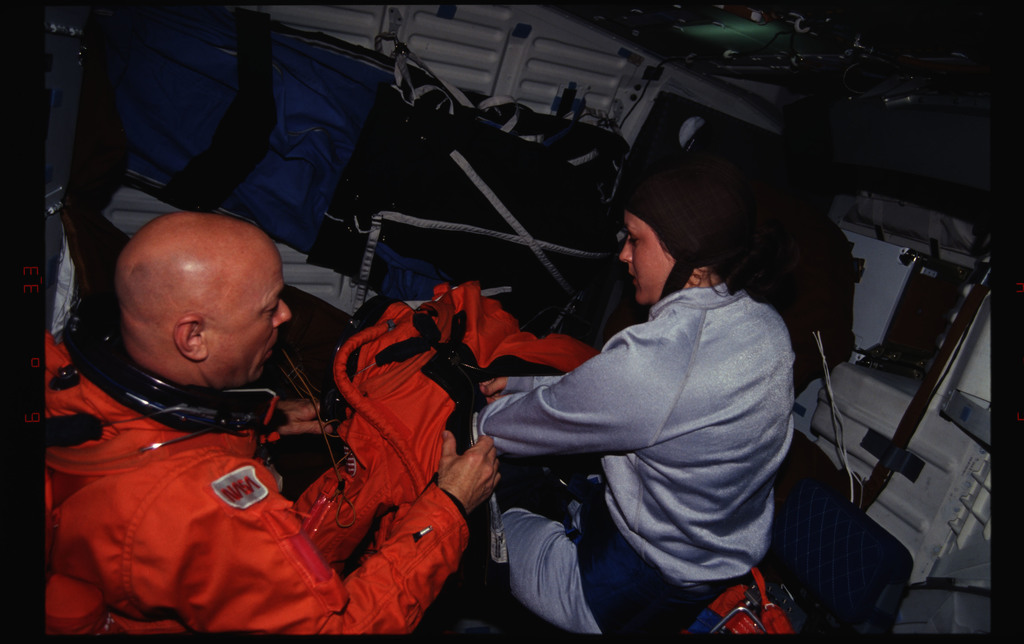 STS061-31-015 - STS-061 - Various views of the STS-61 crew on middeck preparing for re-entry