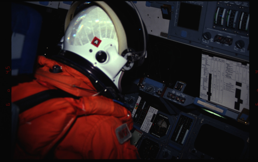 STS061-31-024 - STS-061 - Various views of the STS-61 crew on flight deck preparing for re-entry