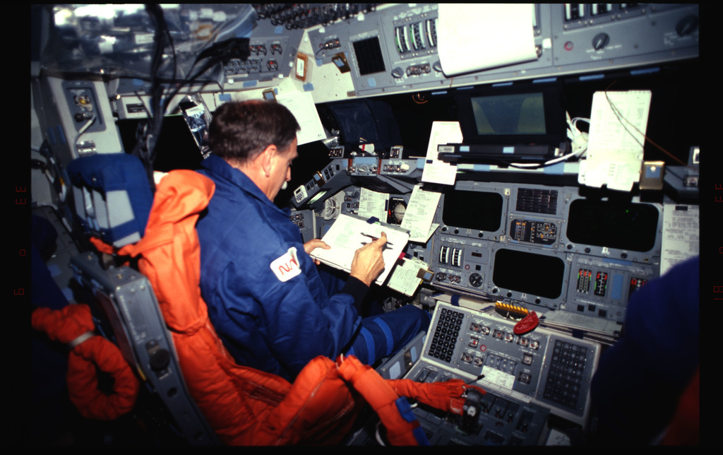 STS061-32-033 - STS-061 - Various views of the STS-61 crew post insertion on the flight deck