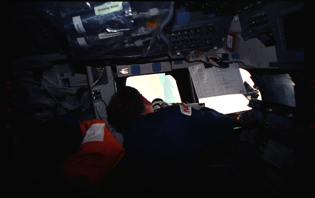 STS061-32-035 - STS-061 - Various views of the STS-61 crew post insertion on the flight deck
