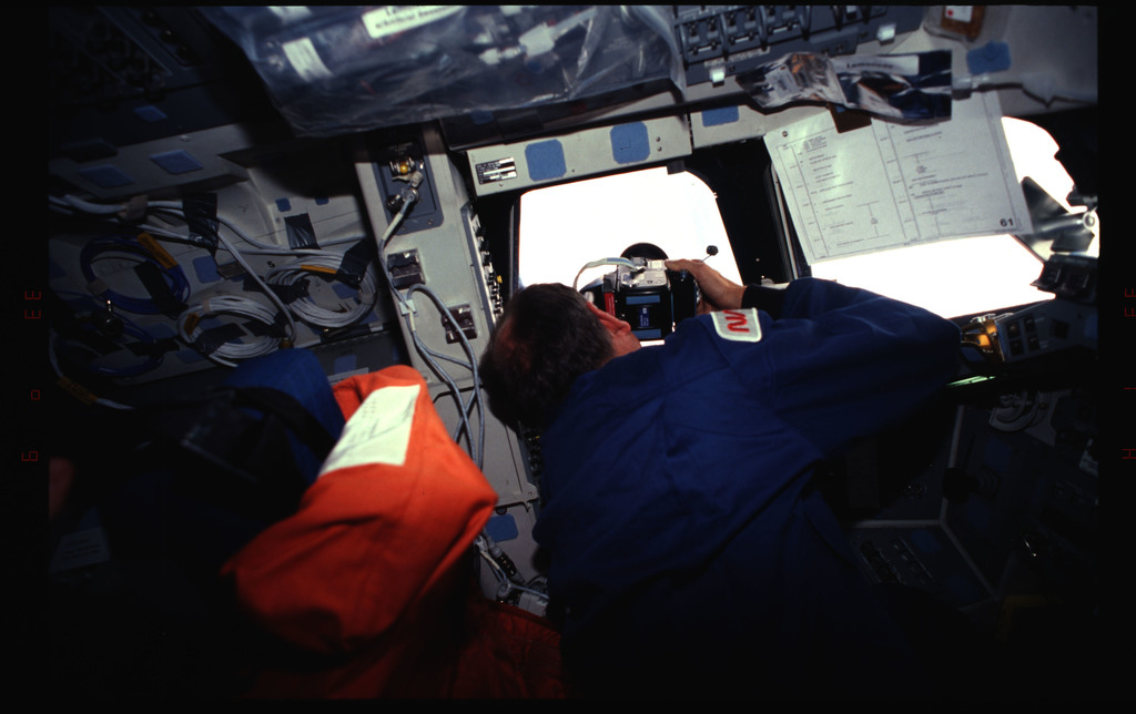 STS061-32-036 - STS-061 - Various views of the STS-61 crew post insertion on the flight deck