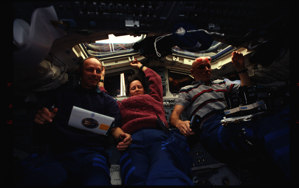 STS061-34-017 - STS-061 - Various views of the STS-61 crew on the flight deck