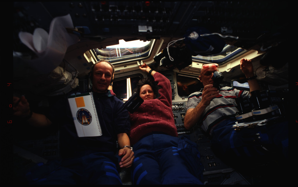 STS061-34-018 - STS-061 - Various views of the STS-61 crew on the flight deck