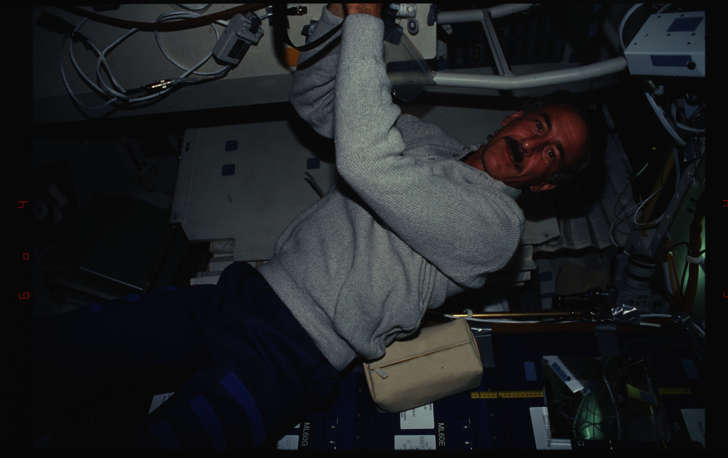 STS061-34-026 - STS-061 - Various views of the STS-61 crew on the middeck