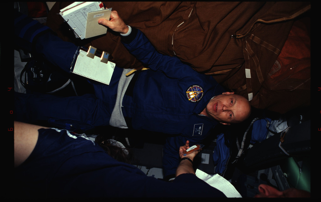 STS061-34-031 - STS-061 - Various views of the STS-61 crew on the middeck