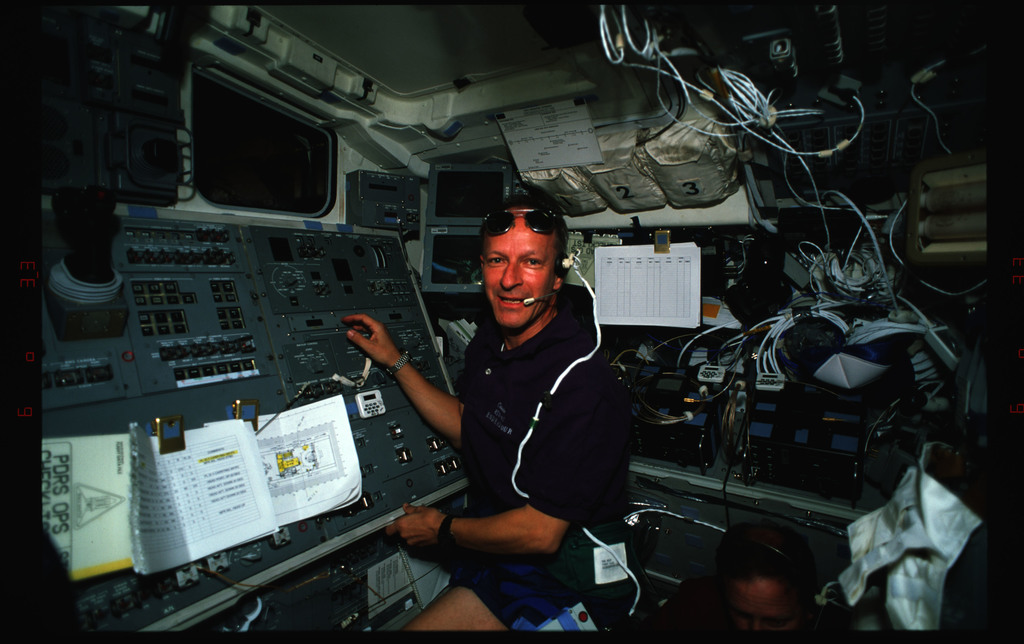 STS061-35-001 - STS-061 - Various views of the STS-61 crew on the Endeavour's flight deck