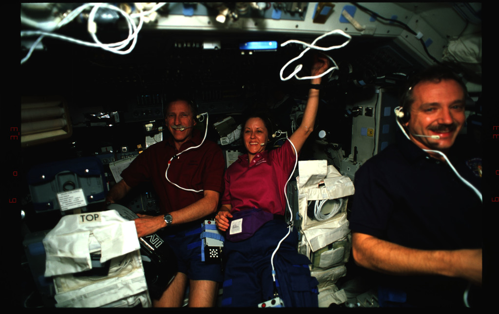 STS061-35-004 - STS-061 - Various views of the STS-61 crew on the Endeavour's flight deck