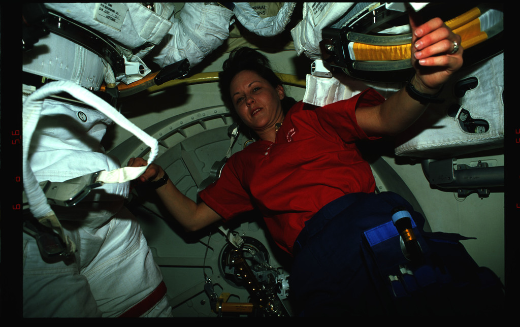 STS061-38-017 - STS-061 - Various views of STS-61 crewmembers on the middeck preparing for an EVA