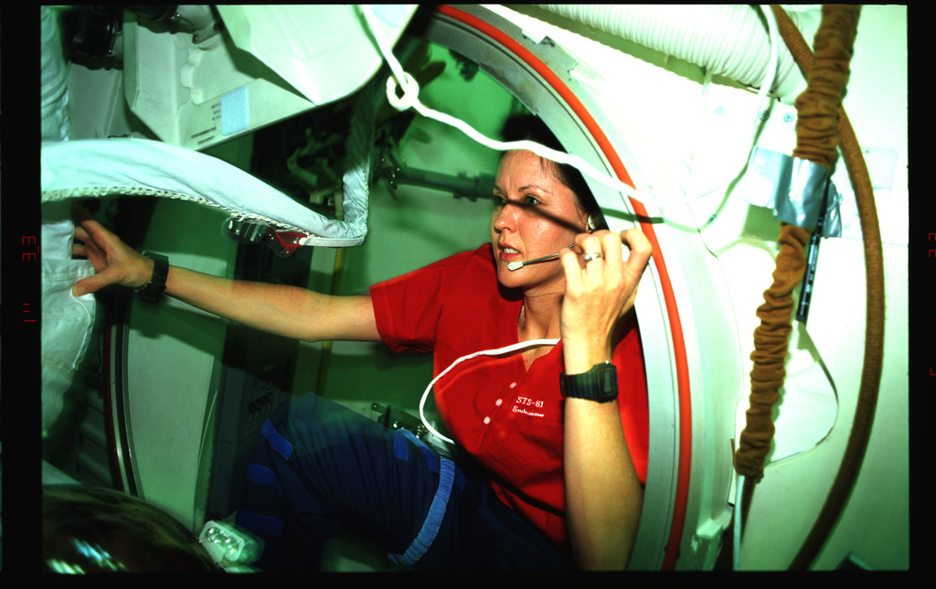 STS061-38-024 - STS-061 - Various views of STS-61 crewmembers on the middeck preparing for an EVA