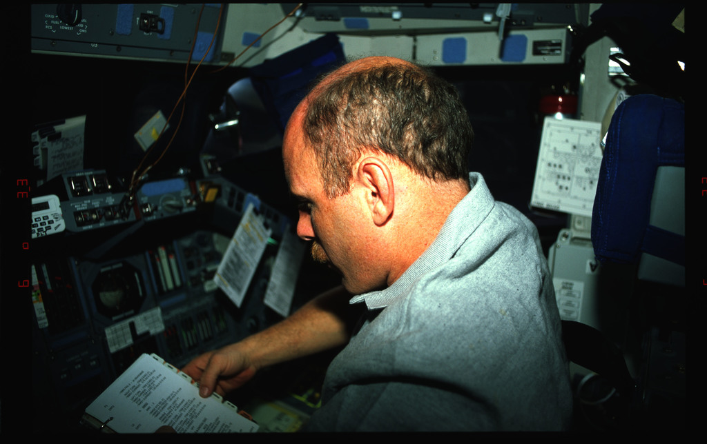 STS061-42-002 - STS-061 - Various views of the STS-61 crew on the flight deck