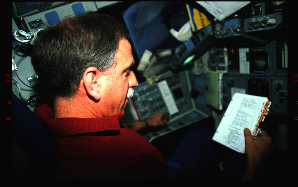 STS061-42-003 - STS-061 - Various views of the STS-61 crew on the flight deck