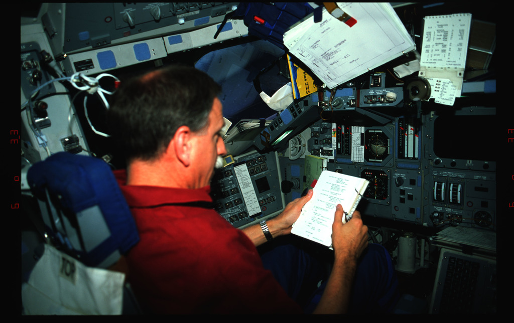 STS061-42-006 - STS-061 - Various views of the STS-61 crew on the flight deck