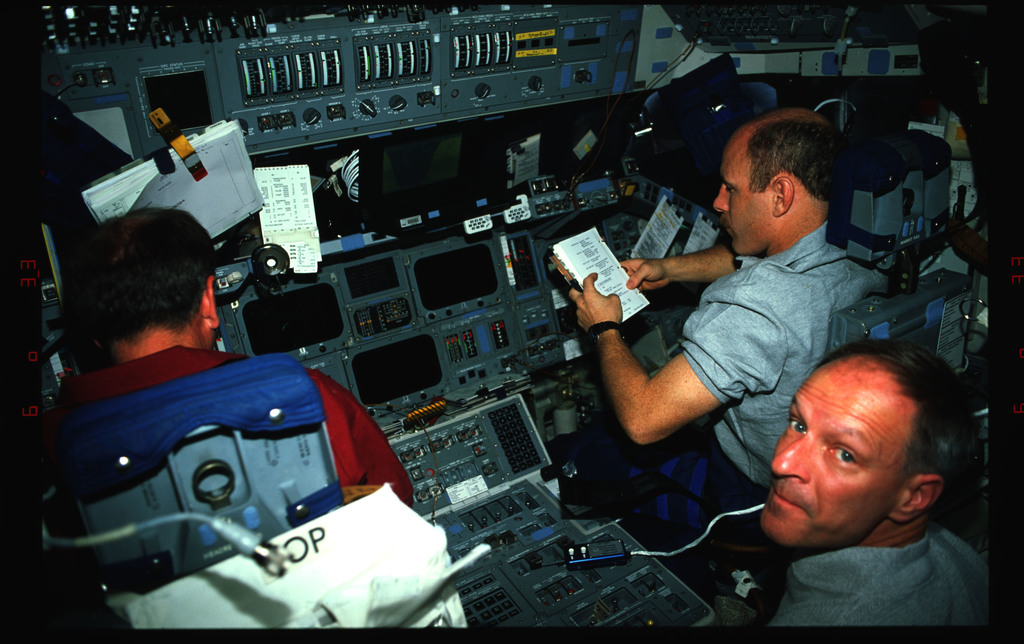 STS061-42-008 - STS-061 - Various views of the STS-61 crew on the flight deck