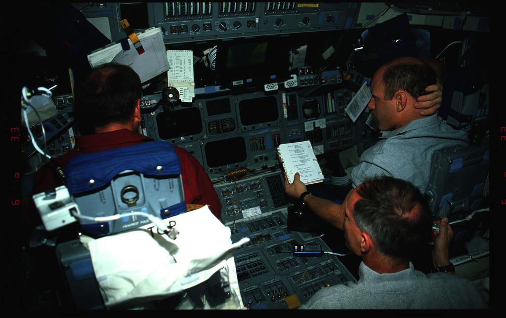 STS061-42-009 - STS-061 - Various views of the STS-61 crew on the flight deck