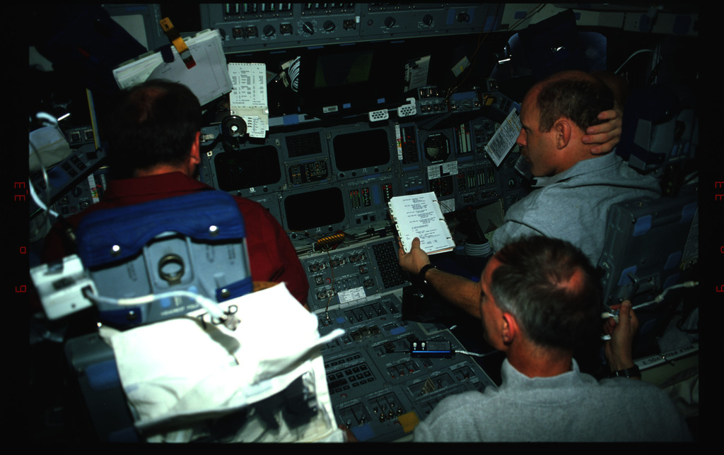 STS061-42-010 - STS-061 - Various views of the STS-61 crew on the flight deck