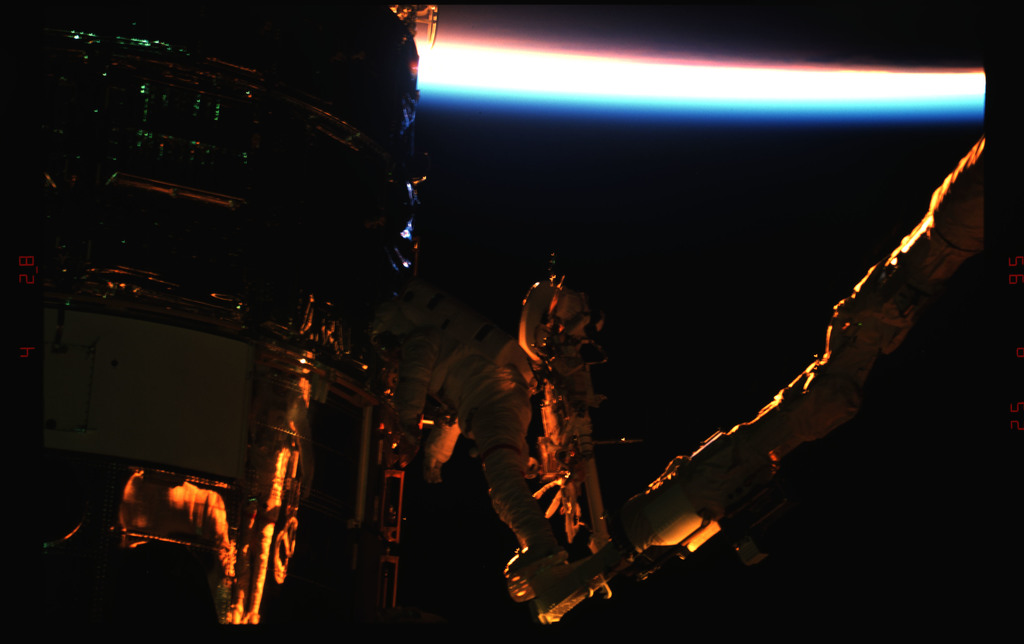 STS061-43-009 - STS-061 - Various views of EVA to replace magnetometers on the HST
