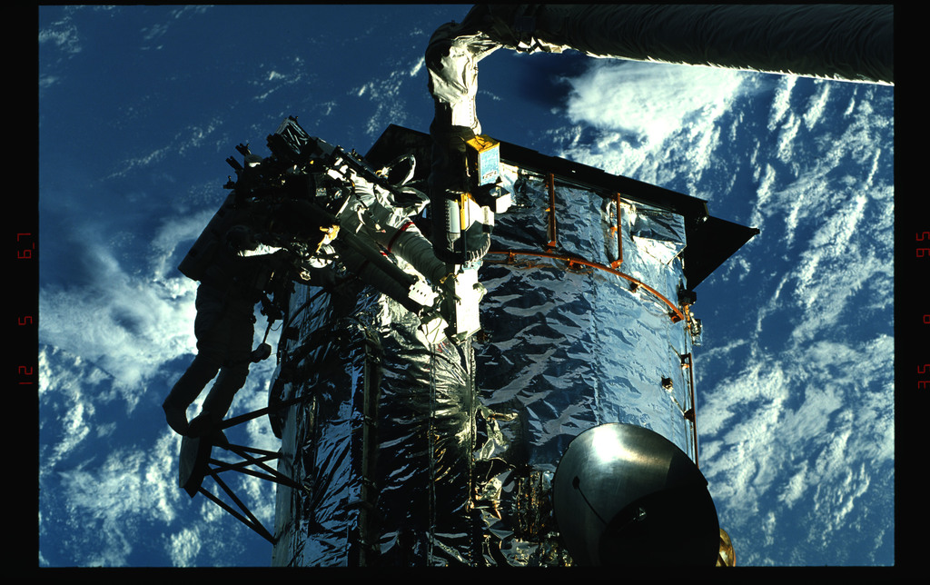 STS061-43-012 - STS-061 - Various views of EVA to replace magnetometers on the HST