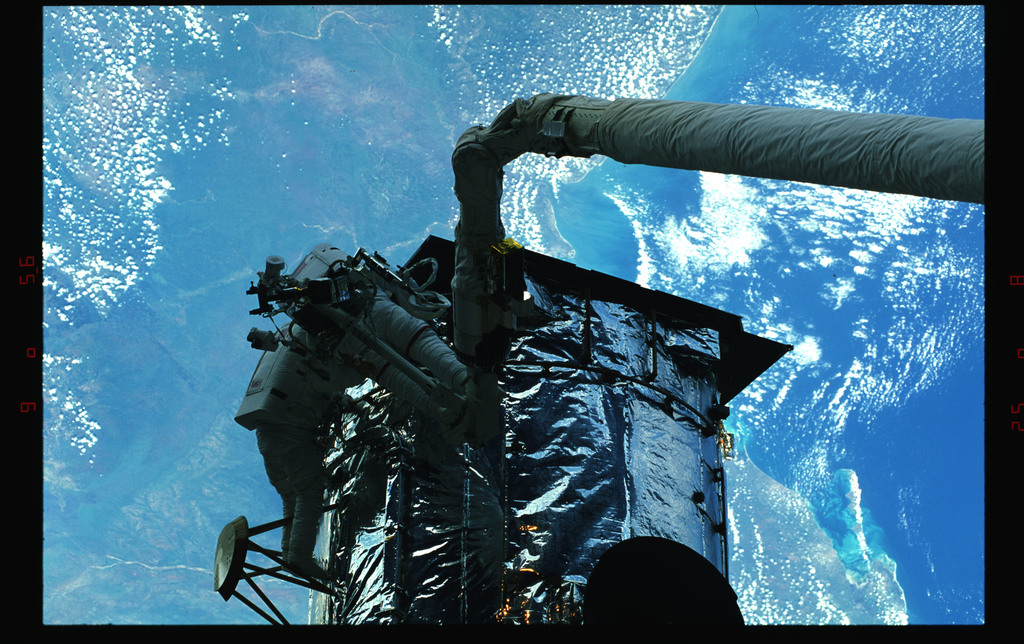 STS061-43-018 - STS-061 - Various views of EVA to replace magnetometers on the HST