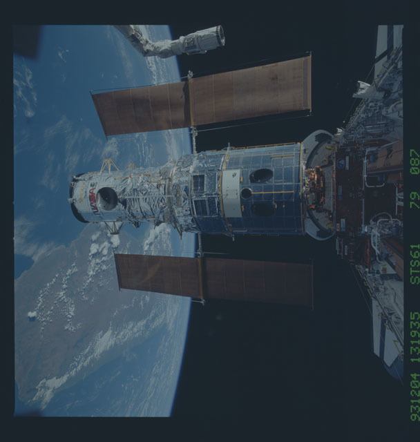 STS061-79-087 - STS-061 - Hubble Space Telescope is berthed in Endeavour's payload bay after capture