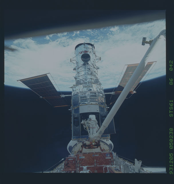 STS061-86-042 - STS-061 - Various views of the capture and first EVA to repair the HST