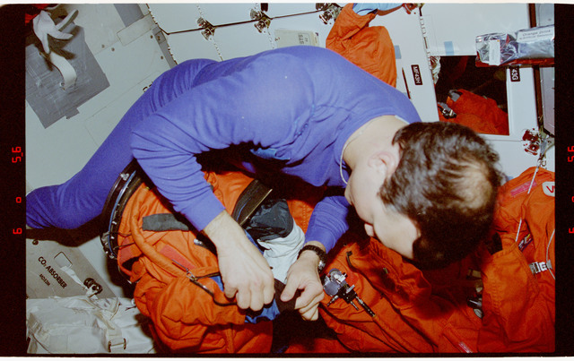 STS062-15-033 - STS-062 - MS Thuot preparing liquid cooling and ventilation garments