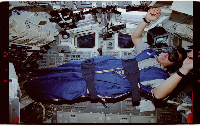 STS062-22-009 - STS-062 - Pilot Allen in sleep restraints aboard Columbia