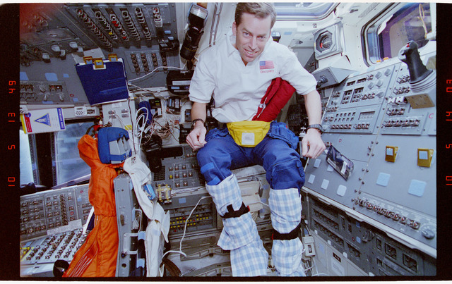 STS063-41-022 - STS-063 - Cdr. Wetherbee wearing towels on his legs